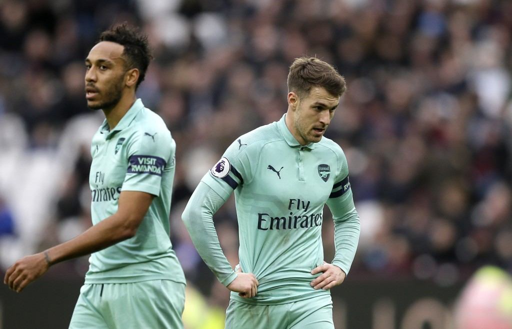 Arsenal's Aaron Ramsey and Pierre-Emerick Aubameyang, left, react during the English Premier League soccer match between West Ham United and Arsenal a