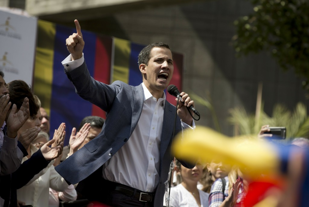 Juan Guaido, President of the Venezuelan National Assembly delivers a speech during a public session with opposition members, at a street in Caracas, ...