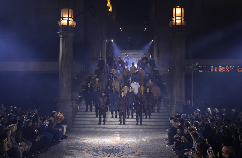 Models wear creations as part of the Ermenegildo Zegna men's Fall-Winter 2019-20 collection, unveiled during the Fashion Week in Milan, Italy, Friday,