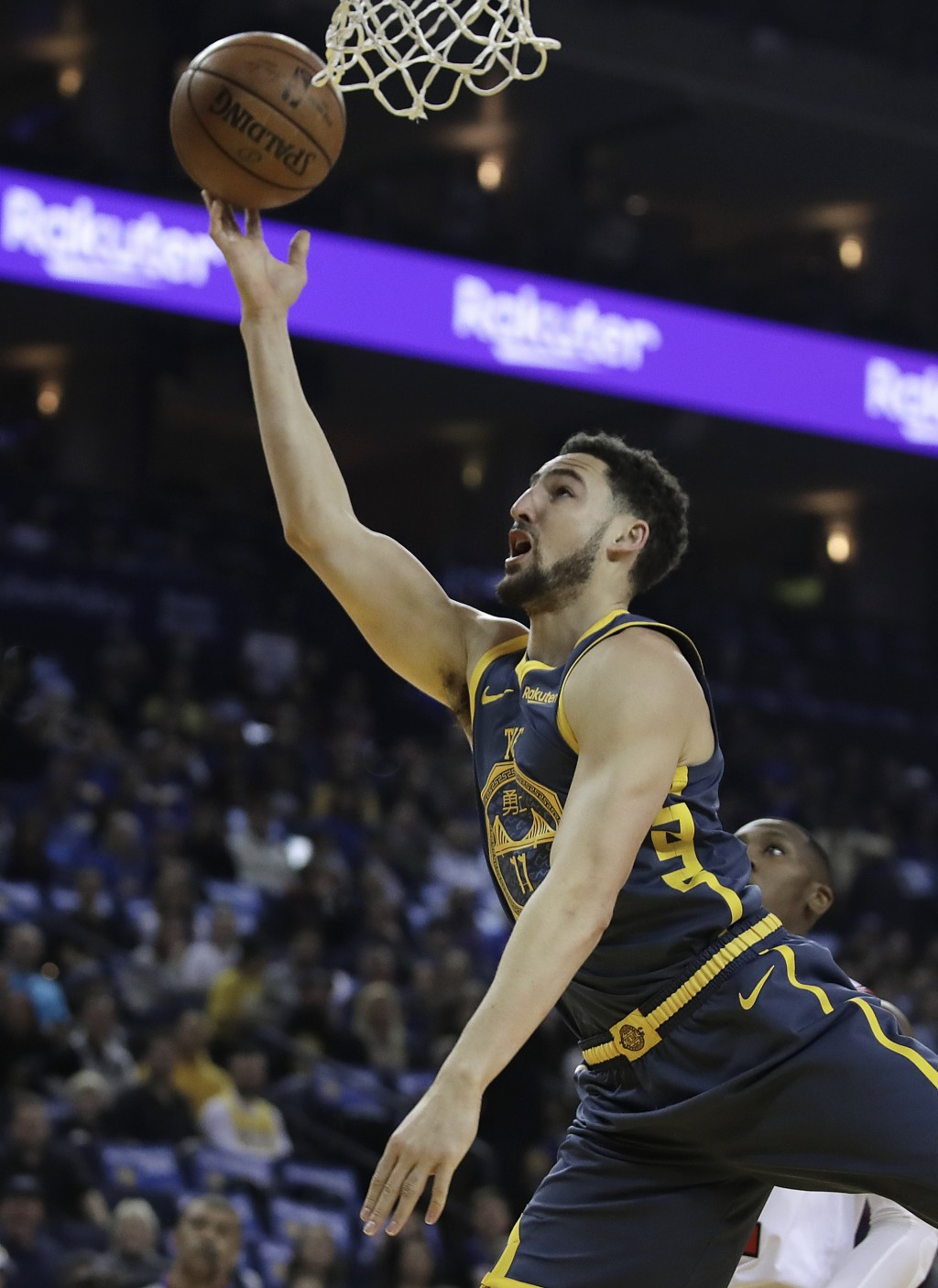 Golden State Warriors' Klay Thompson lays up a shot against the Chicago Bulls during the first half of an NBA basketball game Friday, Jan. 11, 2019, i