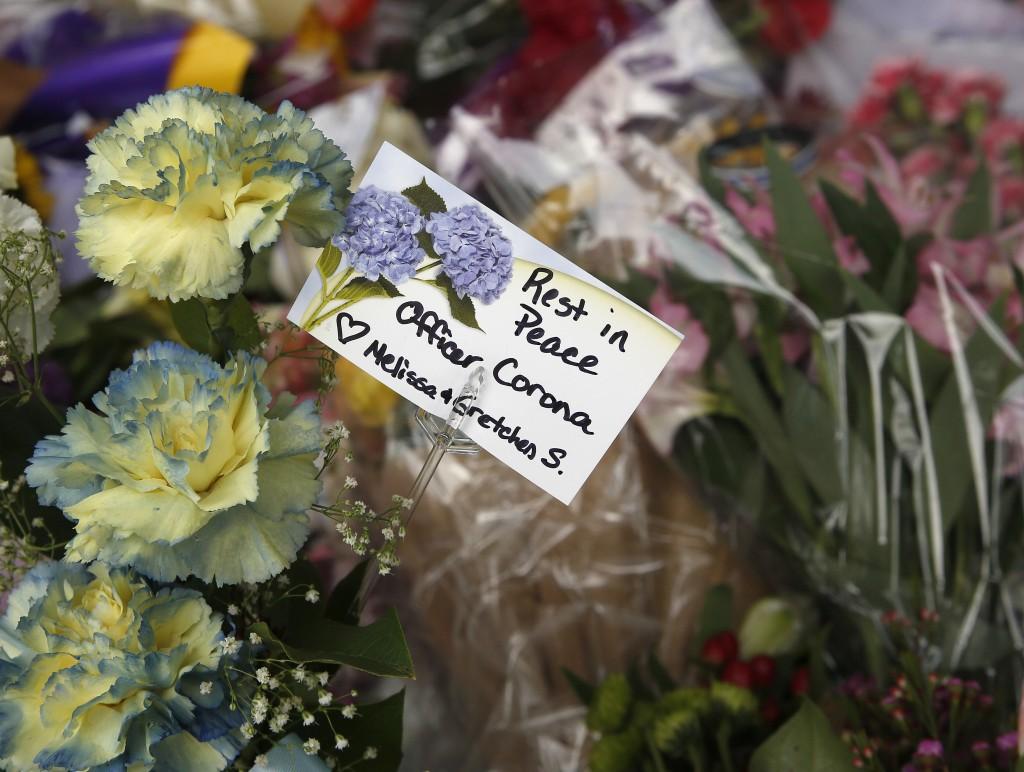 Flowers are seen on a memorial outside the Davis Police Department for slain Davis Police Officer Natalie Corona, Friday, Jan. 11, 2019, in Davis, Cal