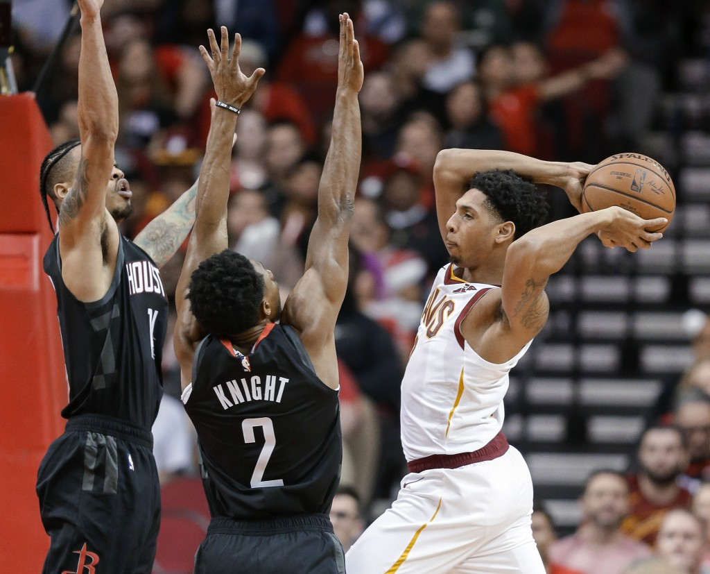 Cleveland Cavaliers guard Cameron Payne, right, passes the ball as Houston Rockets guards Brandon Knight (2) and Gerald Green defend during the first
