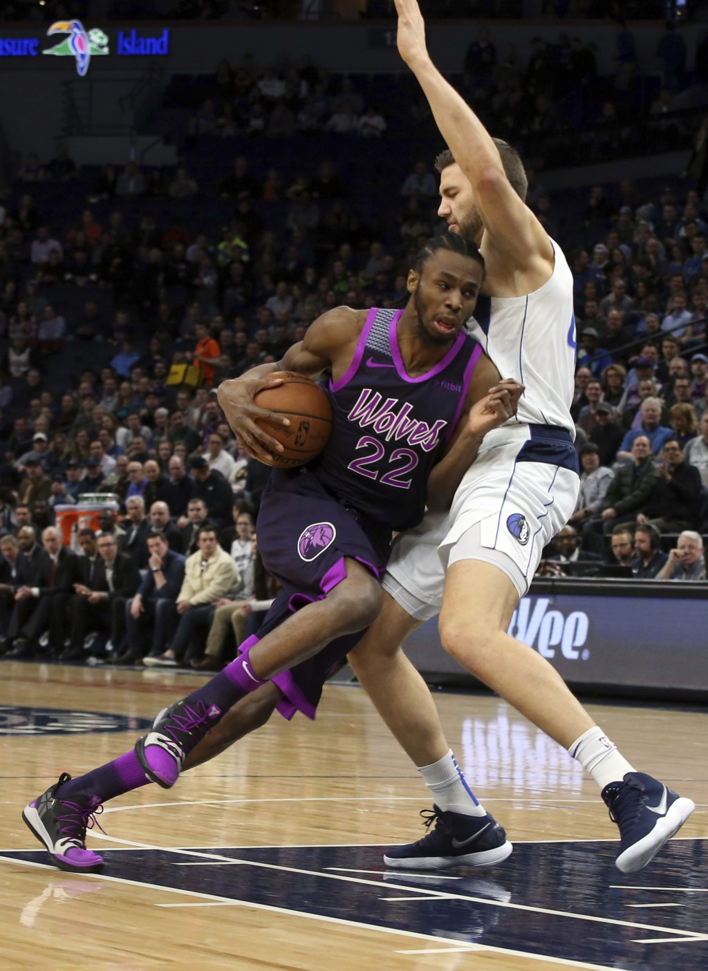 Minnesota Timberwolves' Andrew Wiggins, left, drives on Dallas Mavericks' Maximilian Kleber, of Germany, in the first half of an NBA basketball game F