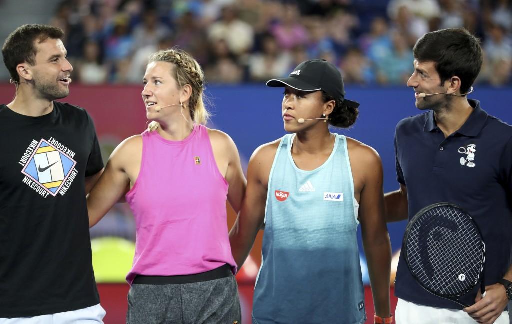 Australian Open player's from left, Bulgaria's Grigor Dimitrov, Victoria Azarenka of Belarus, Japan's Naomi Osaka and Serbia's Novak Djokovic embrace