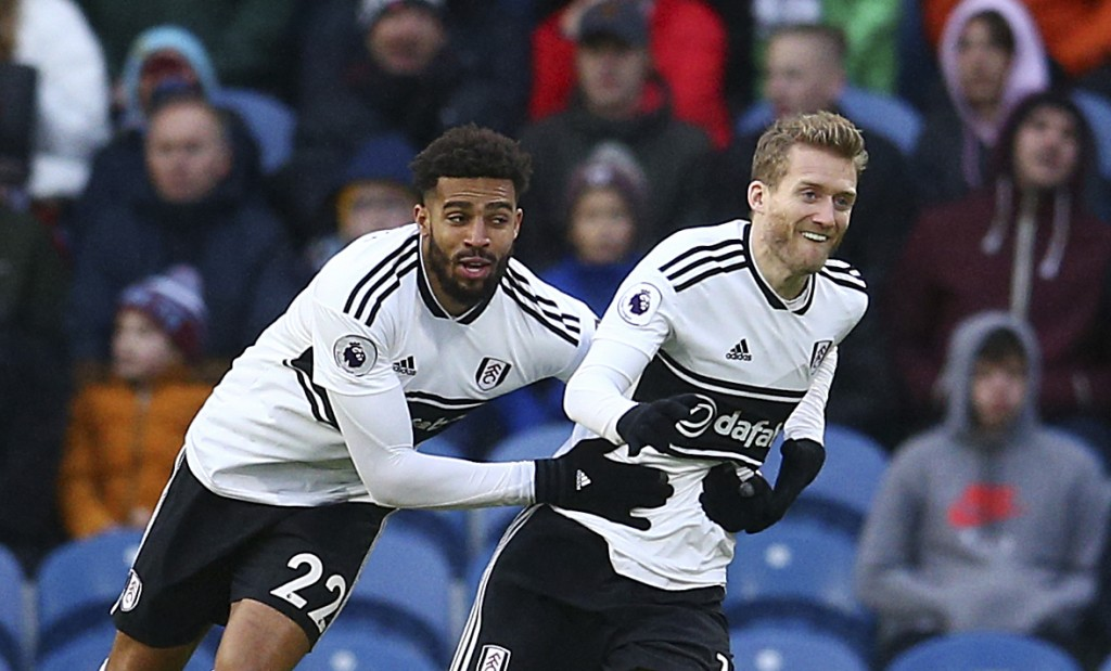 Fulham's Andre Schurrle, right, celebrates scoring his side's first goal of the game during the English Premier League soccer match between Burnley F.