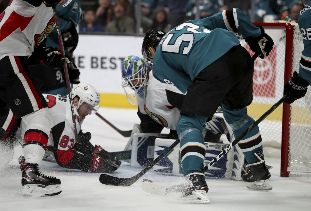 San Jose Sharks center Lukas Radil (52) has a shot blocked by Ottawa Senators goaltender Anders Nilsson (31) during the first period of an NHL hockey