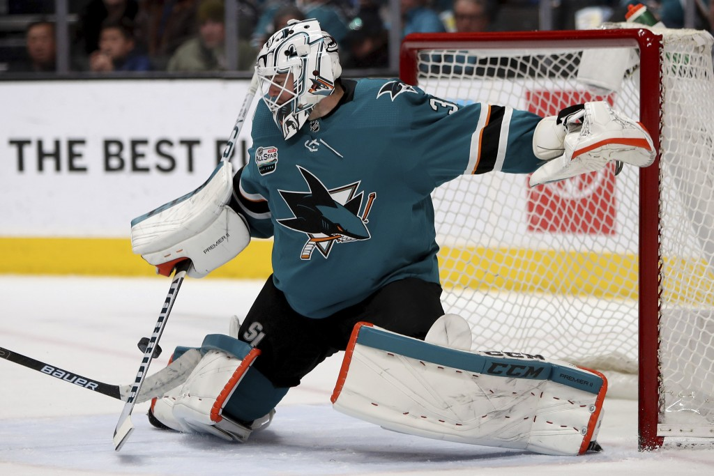 San Jose Sharks goaltender Martin Jones defends on a shot from the Ottawa Senators during the second period in an NHL hockey game in San Jose, Calif.,