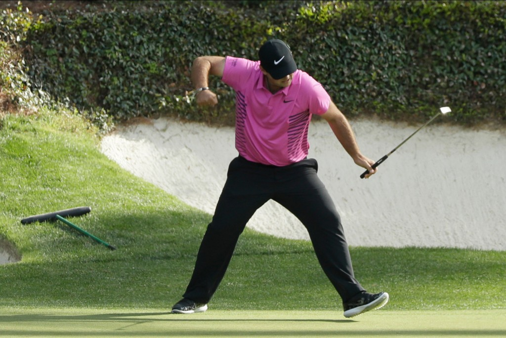 FILE- In this April 8, 2018, file photo, Patrick Reed reacts to his birdie on the 12th hole during the fourth round at the Masters golf tournament in