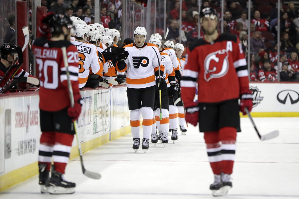 Philadelphia Flyers left wing James van Riemsdyk, center, skates by the bench after scoring a goal on the New Jersey Devils during the second period o