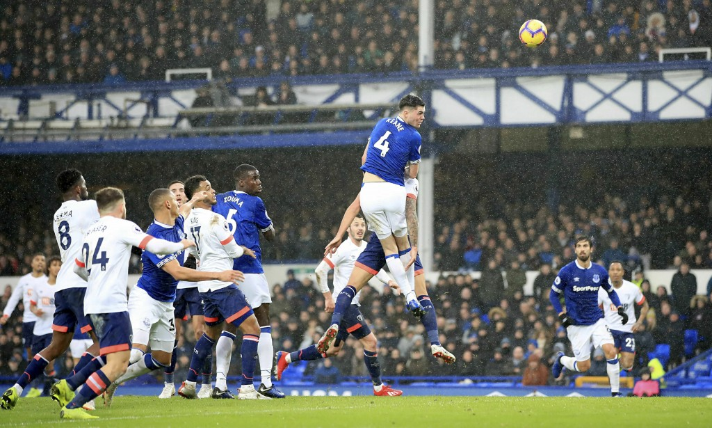 Everton's Michael Keane heads towards goal during their English Premier League soccer match against AFC Bournemouth at Goodison Park, Liverpool, Engla