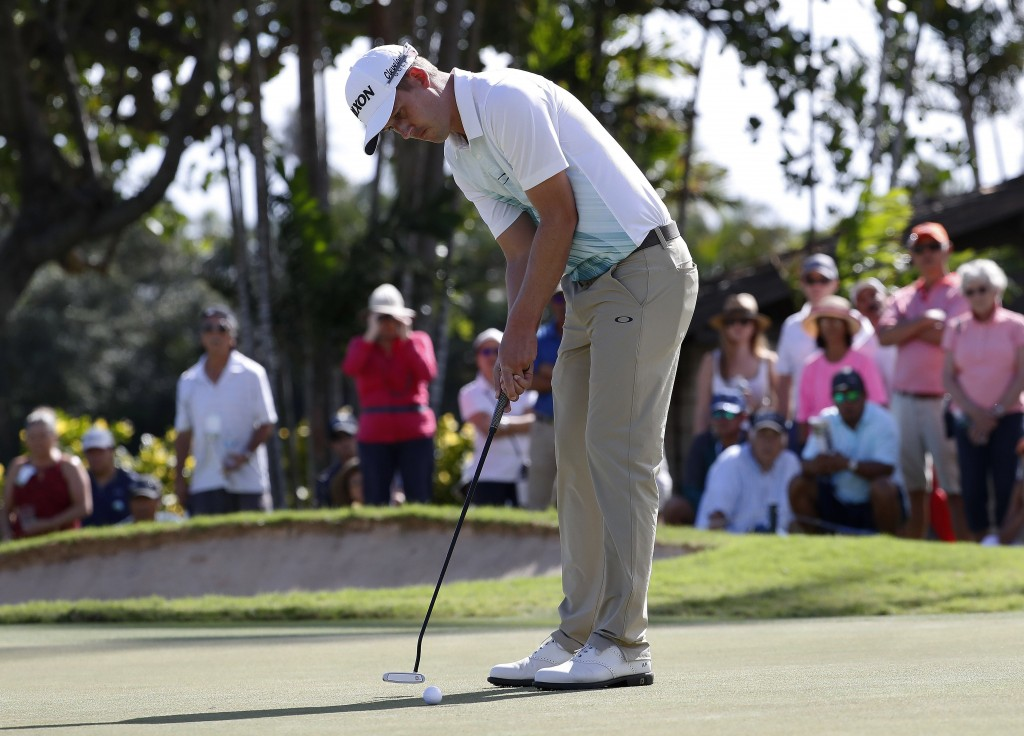 Andrew Putman putts on the third green during the third round of the Sony Open golf tournament Saturday, Jan. 12, 2019, at Waialae Country Club in Hon...