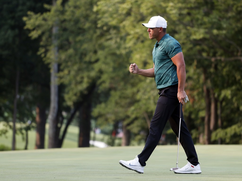 FILE- In this Aug. 12, 2018, file photo Brooks Koepka celebrates after making his birdie putt on the 16th green during the final round of the PGA Cham