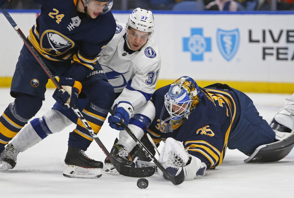 Buffalo Sabres goalie Linus Ullmark (35) stops Tampa Bay Lightning forward Yanni Gourde (37) during the second period of an NHL hockey game, Saturday,...