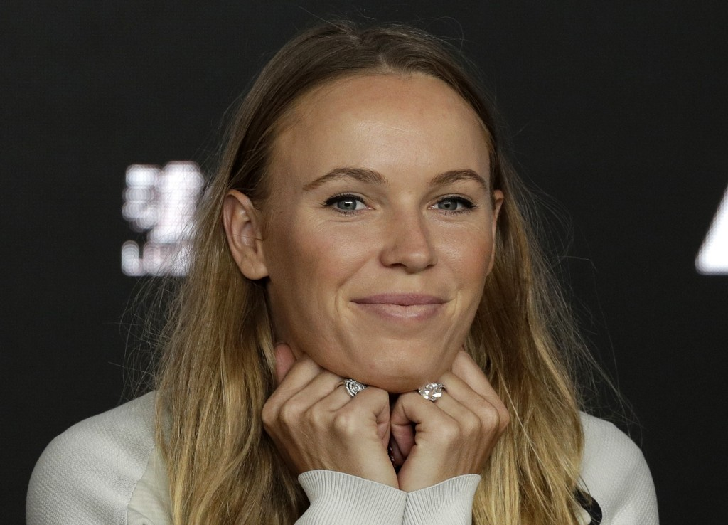 Defending women's singles champion Denmark's Caroline Wozniacki answers questions during a press conference at the Australian Open tennis championship