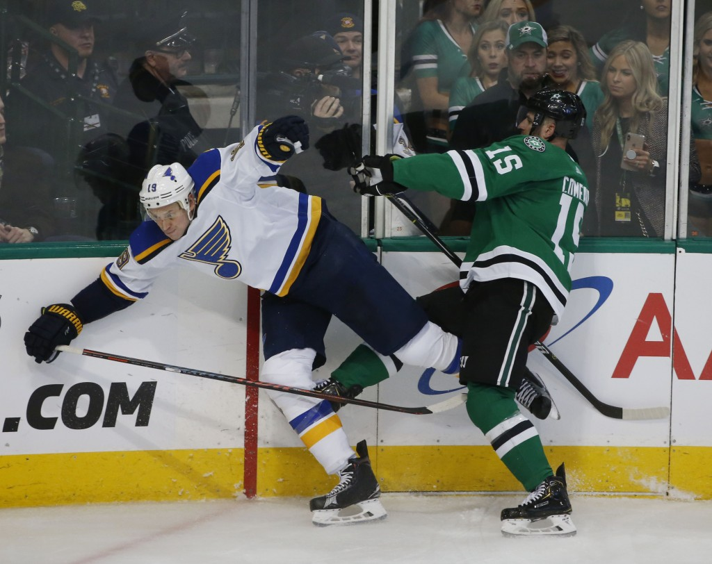 St. Louis Blues defenseman Jay Bouwmeester (19) gets hit by Dallas Stars left wing Blake Comeau (15) along the boards during the third period of an NH