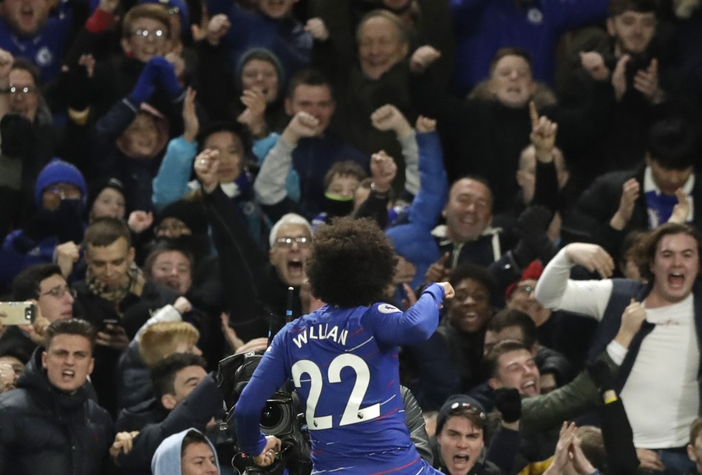 Chelsea's Willian celebrates his side's second goal during the English Premier League soccer match between Chelsea and Newcastle United at Stamford Br