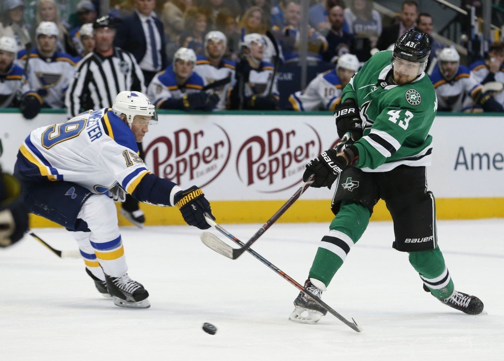 St. Louis Blues defenseman Jay Bouwmeester (19) defends a shot by Dallas Stars right wing Valeri Nichushkin (43) during the first period of an NHL hoc