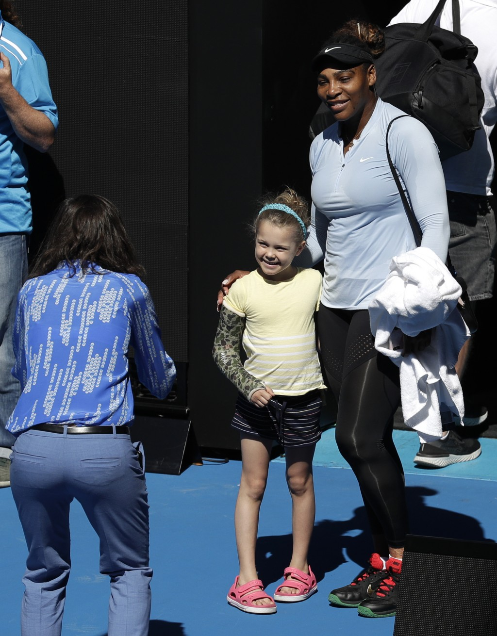 United States' Serena Williams poses for. Photo with a young fan following a practice session at the Australian Open tennis championships in Melbourne