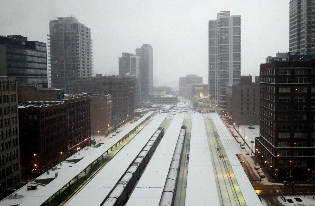 Commuter trains are parked at the LaSalle Street station under a heavy snow fall in downtown Chicago, Saturday, Jan. 12, 2019. A winter weather adviso