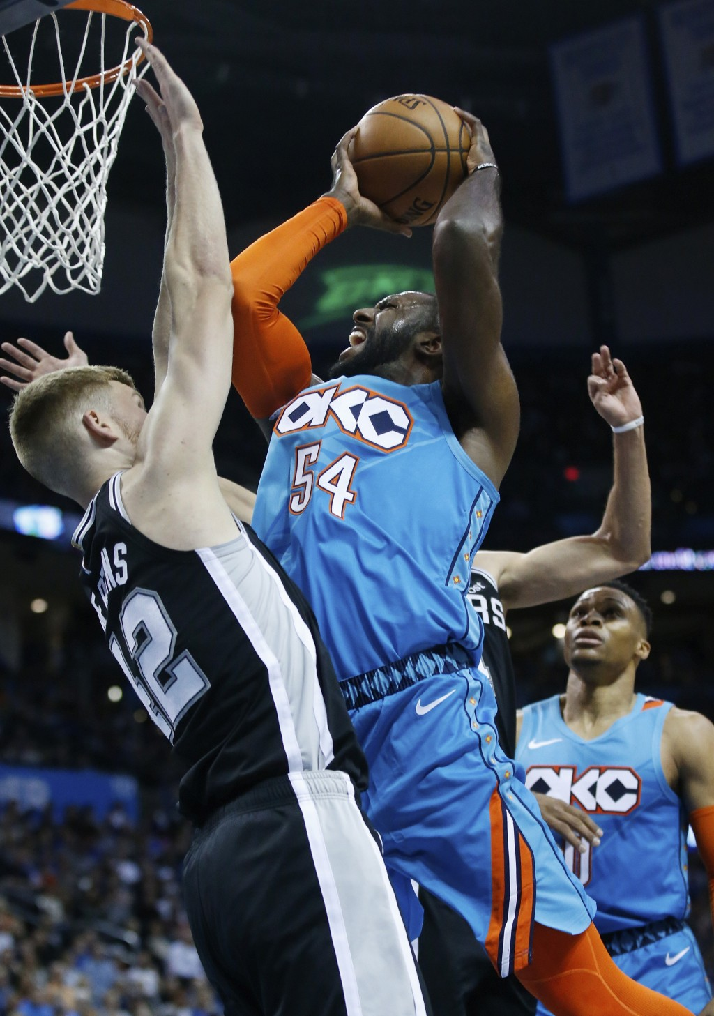 Oklahoma City Thunder forward Patrick Patterson (54) shoots as San Antonio Spurs forward Davis Bertans (42) defends in the first half of an NBA basket