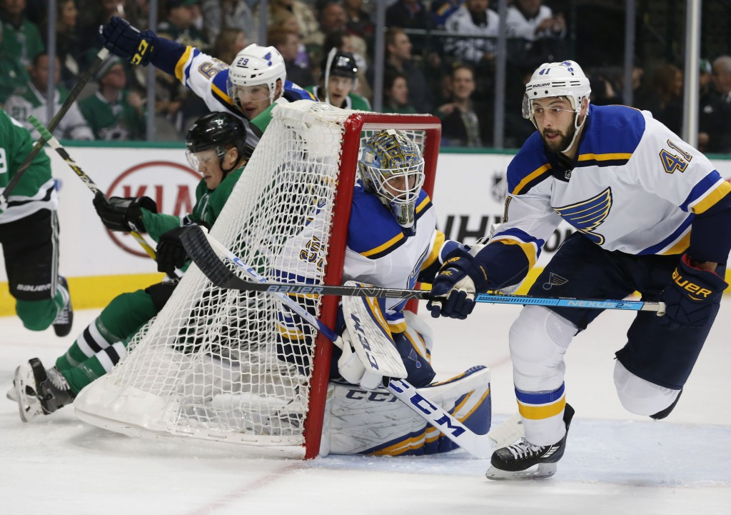 Dallas Stars right wing Erik Condra (27) is pushed into the back of the net by St. Louis Blues defenseman Vince Dunn (29) as Blues goaltender Jordan B