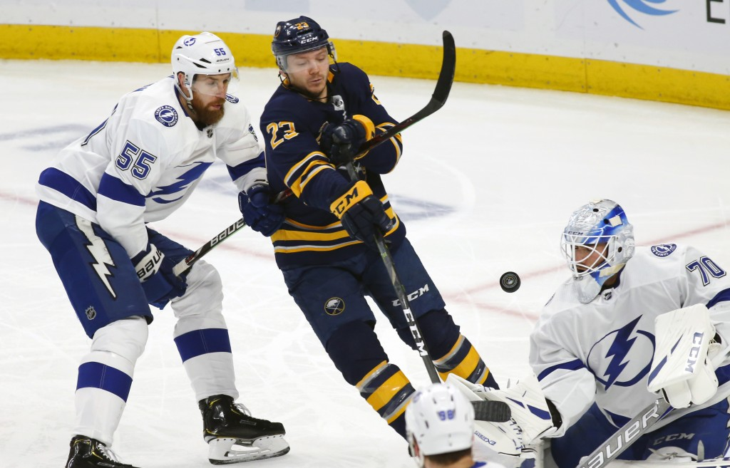 Buffalo Sabres forward Sam Reinhart (23) and Tampa Bay Lightning forward Braydon Coburn (55) battle for the puck during the first period of an NHL hoc...
