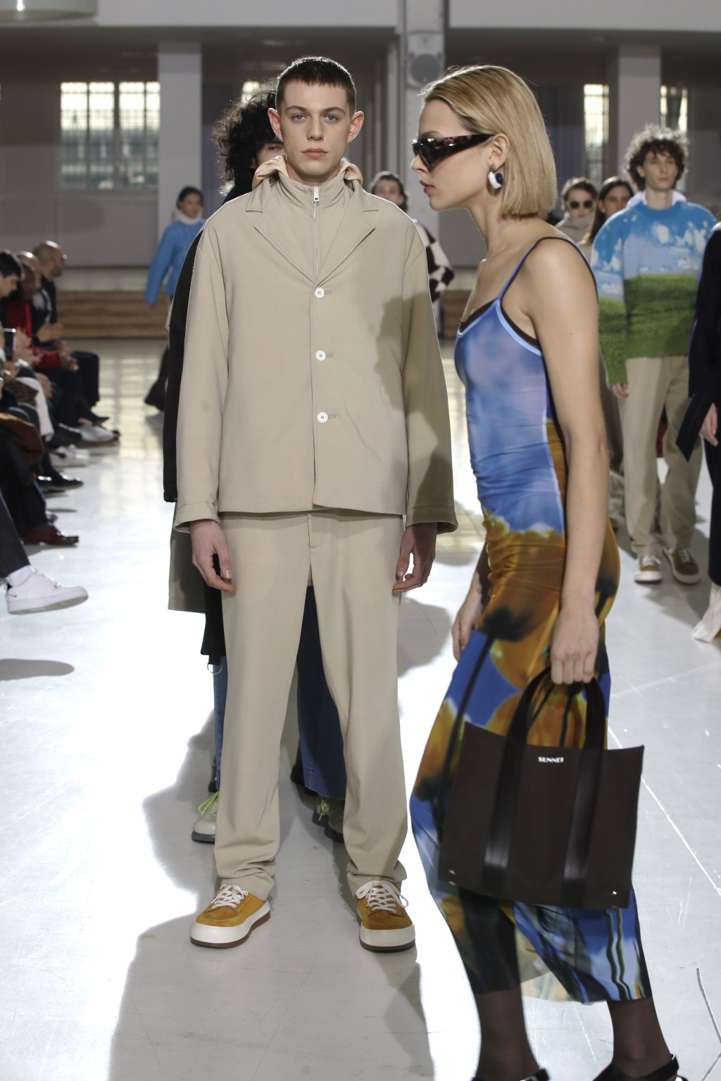 Models wear creations as part of the Sunnei men's Fall-Winter 2019-20 collection, that was presented in Milan, Italy, Sunday, Jan.13, 2019. (AP Photo/