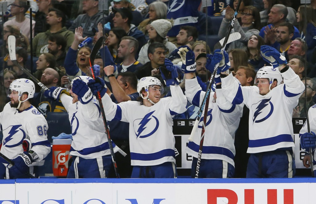 Tampa Bay Lightning players celebrate a goal during the third period of the team's NHL hockey game against the Buffalo Sabres, Saturday, Jan. 12, 2019