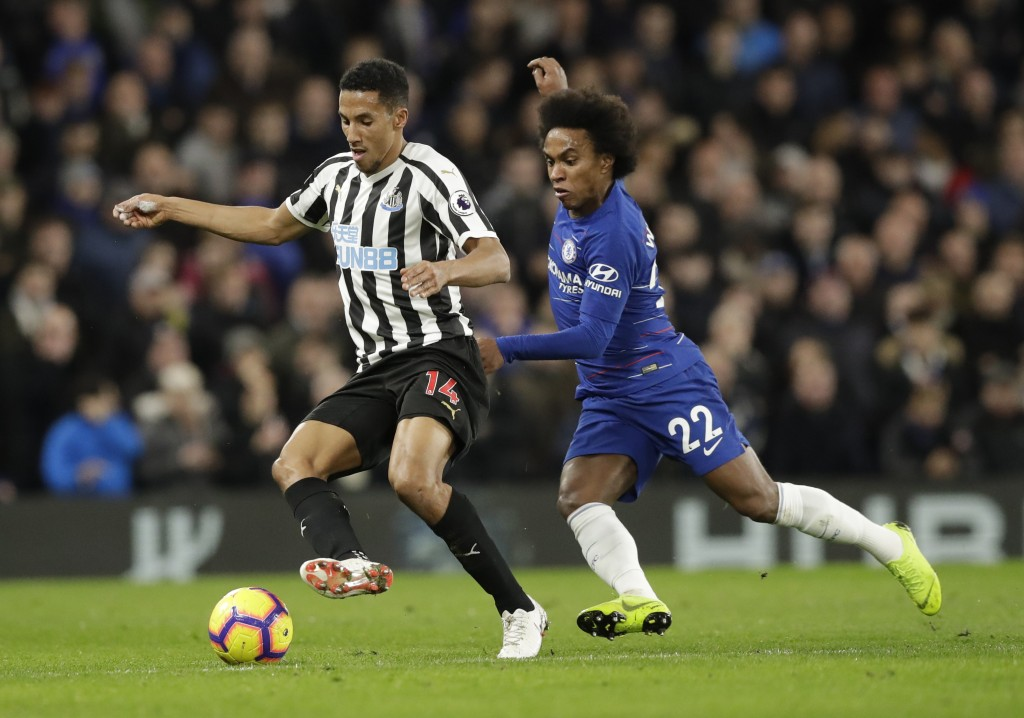 Newcastle United's Isaac Hayden, left, and Chelsea's Willian compete for the ball during the English Premier League soccer match between Chelsea and N