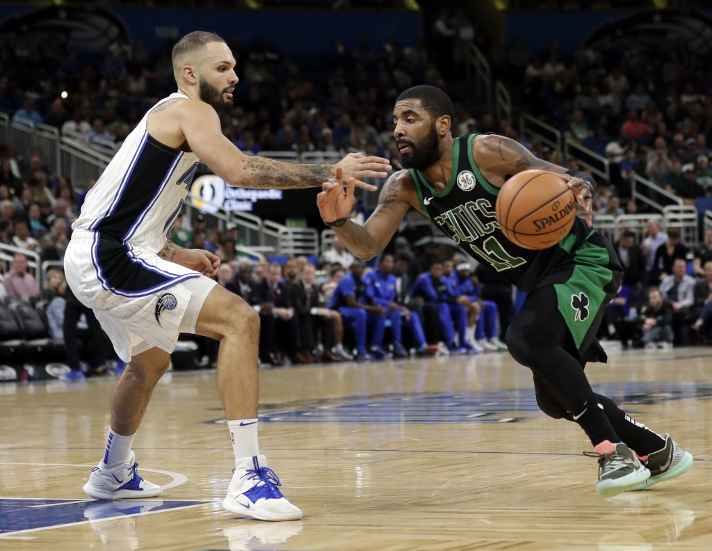 Boston Celtics' Kyrie Irving, right , drives around Orlando Magic's Evan Fournier during the second half of an NBA basketball game, Saturday, Jan. 12,