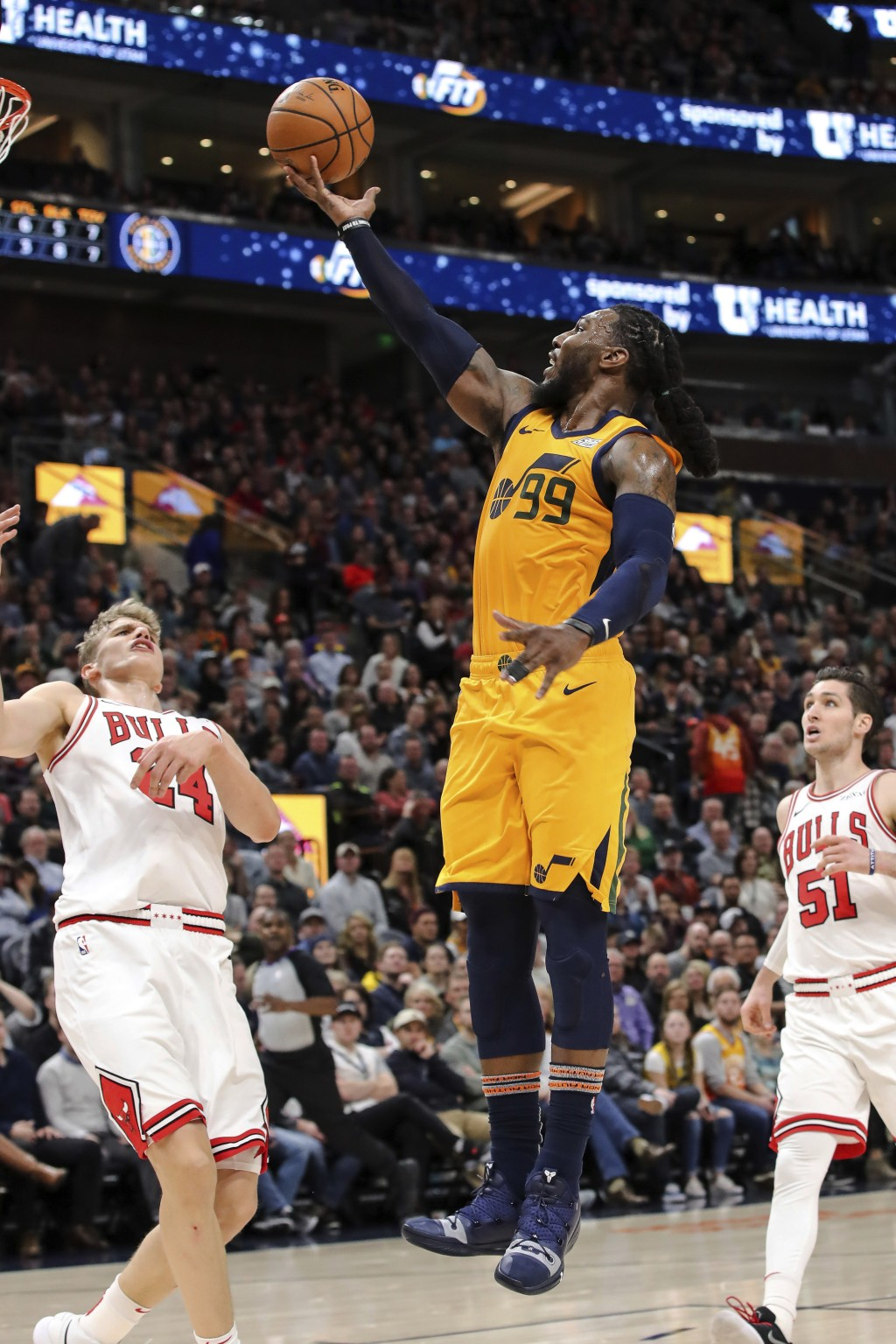 Utah Jazz forward Jae Crowder (99) shoots next to Chicago Bulls' Lauri Markkanen, left, during the second quarter of an NBA basketball game Saturday, ...