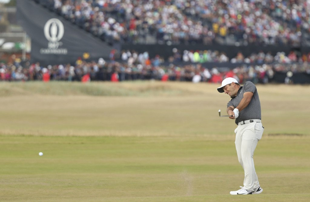 FILE- In this July 22, 2018, file photo Francesco Molinari of Italy plays a shot to the 17th green during the final round for the 147th British Open G