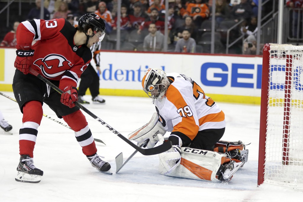 New Jersey Devils center Nico Hischier (13), of Switzerland, scores a goal on Philadelphia Flyers goaltender Carter Hart (79) during the second period