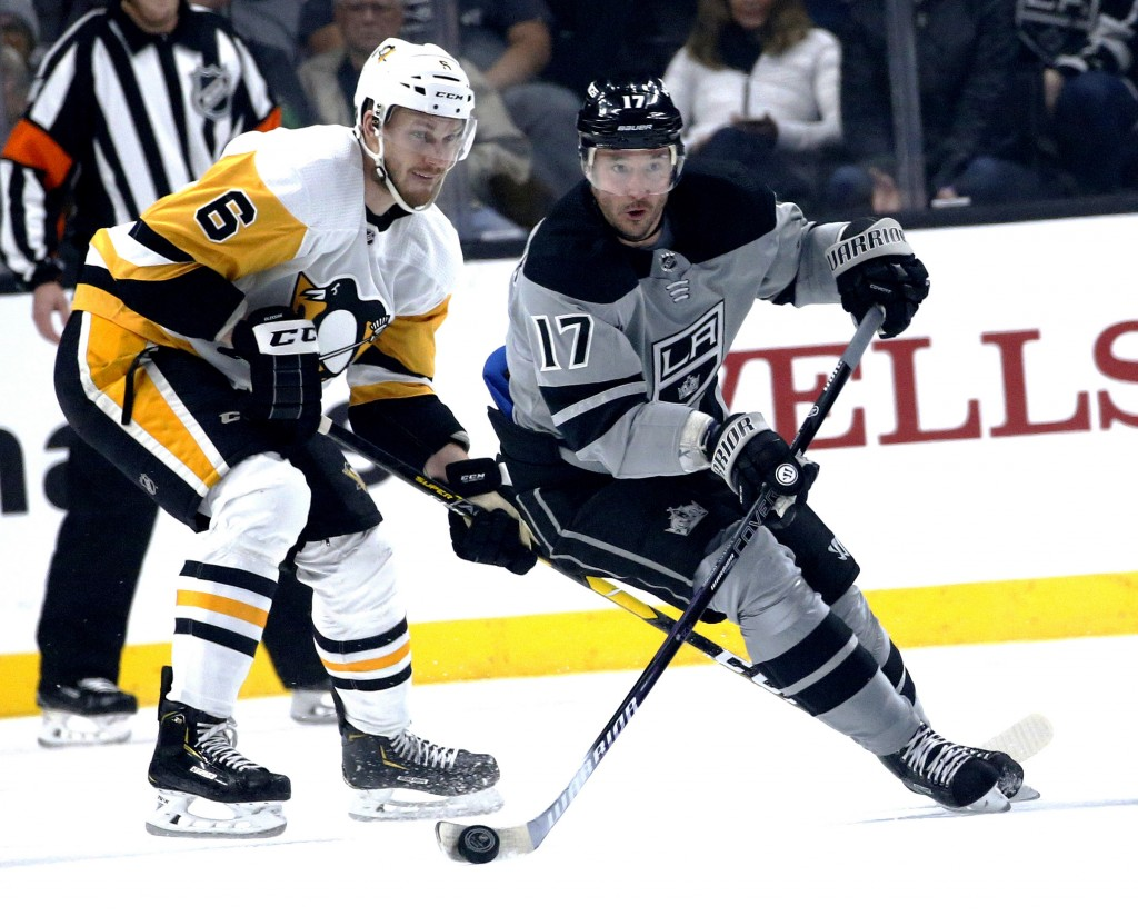 Los Angeles Kings forward Ilya Kovalchuk, right, controls the puck away from Pittsburgh Penguins defenseman Jamie Oleksiak during the first period of