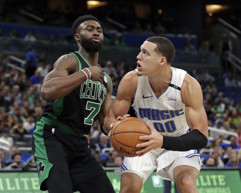 Orlando Magic's Aaron Gordon (00) looks for a shot in front of Boston Celtics' Jaylen Brown (7) during the first half of an NBA basketball game, Satur