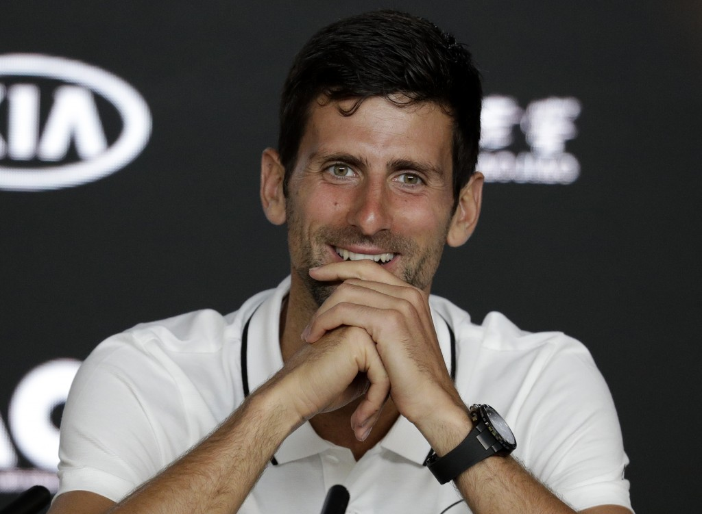 Serbia's Novak Djokovic smiles during a press conference at the Australian Open tennis championships in Melbourne, Australia, Sunday, Jan. 13, 2019. (