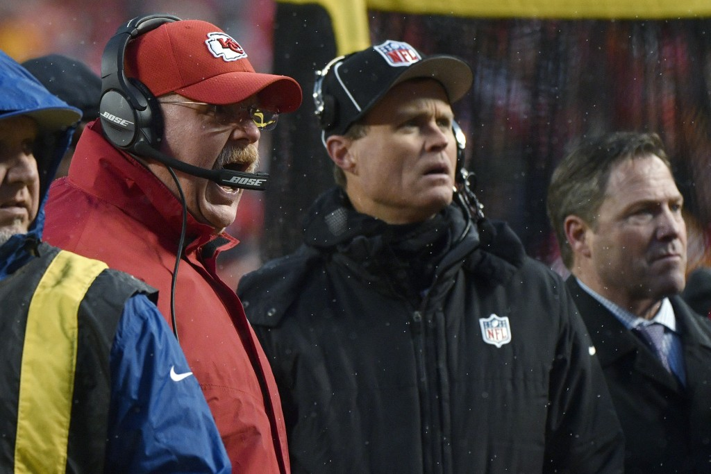 Kansas City Chiefs coach Andy Reid yells to fans in the stands to stop throwing snowballs onto the field, during the first half of the team's NFL divi