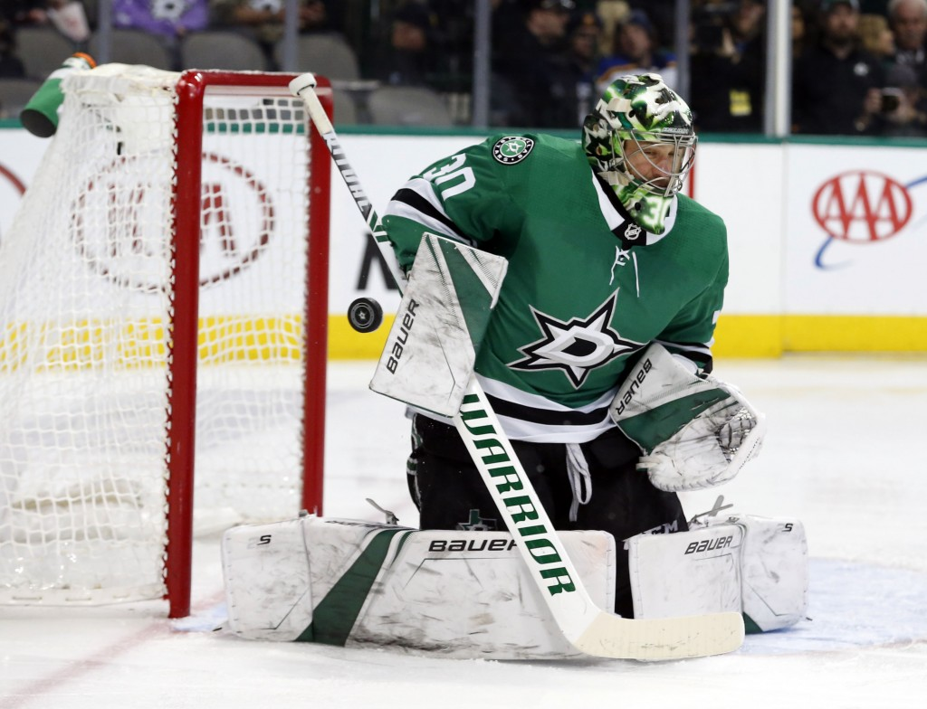 Dallas Stars goaltender Ben Bishop (30) makes a save on a shot by the St. Louis Blues during the second period of an NHL hockey game in Dallas, Saturd
