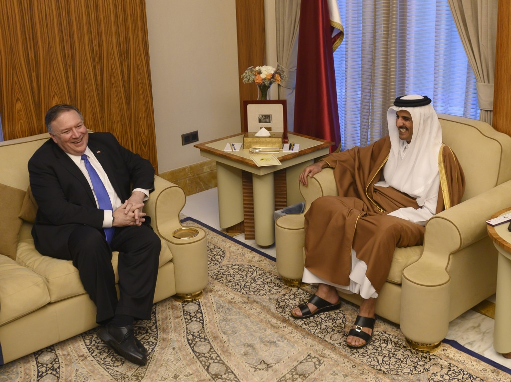 U.S. Secretary of State Mike Pompeo, left, meets with the Qatari Emir Tamim bin Hamad Al Thani, at the Sea Palace, in Doha, Qatar, Sunday, Jan. 13, 20