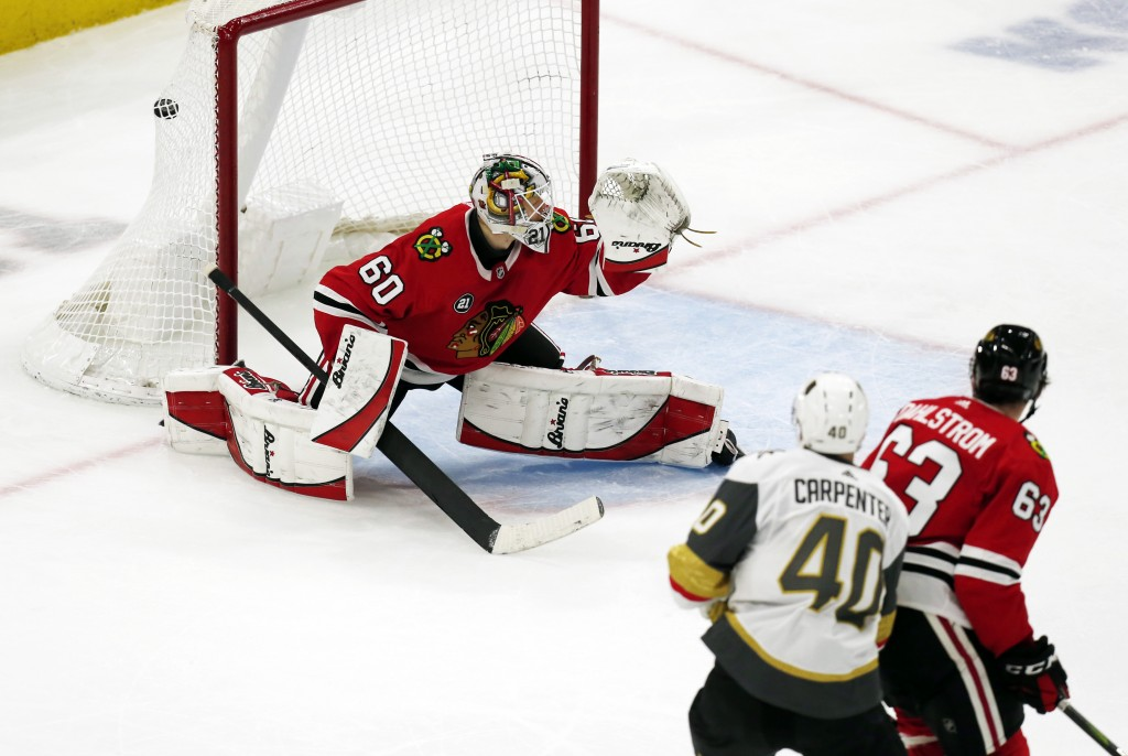 Vegas Golden Knights center Ryan Carpenter (40) scores a goal past Chicago Blackhawks goaltender Collin Delia (60) during the second period of an NHL