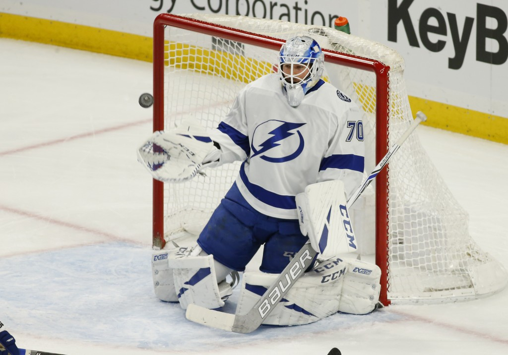Tampa Bay Lightning goalie Louis Domingue (70) makes a save during the first period of an NHL hockey game against the Buffalo Sabres, Saturday, Jan. 1...