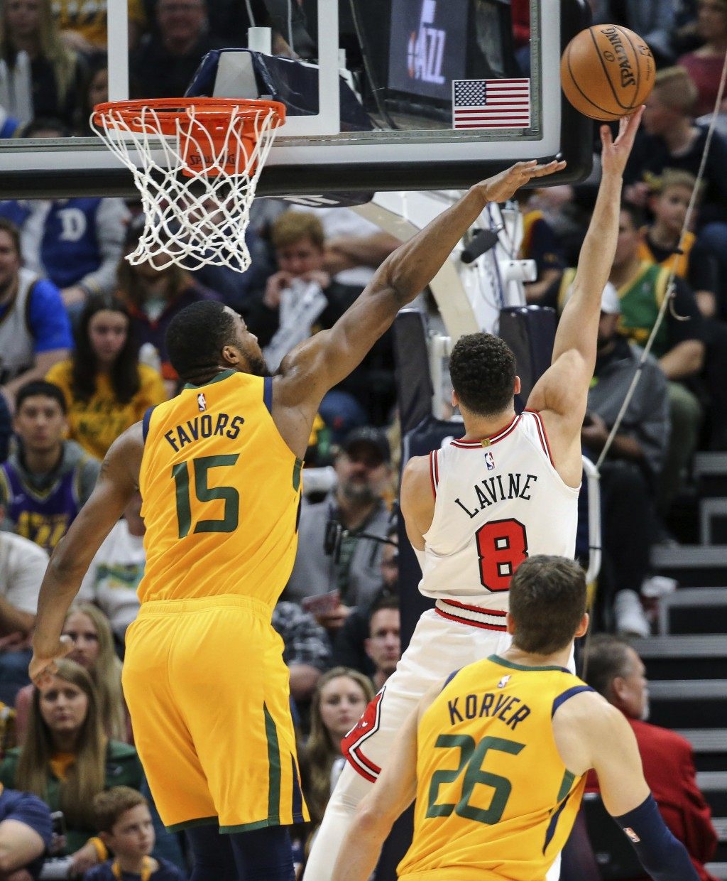 Utah Jazz forward Derrick Favors (15) tries to block the shot of Chicago Bulls guard Zach LaVine (8) during the second quarter of an NBA basketball ga...