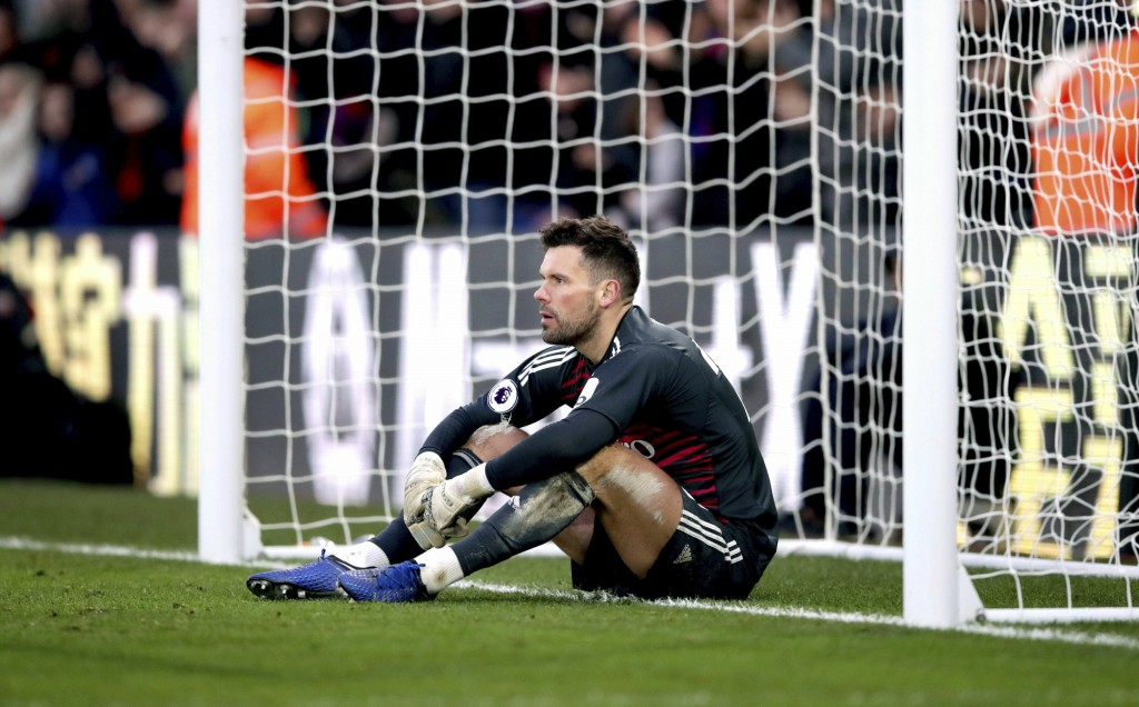 Watford goalkeeper Ben Foster appears dejected as team mate Craig Cathcart (not in picture) scores an own goal during the English Premier League socce
