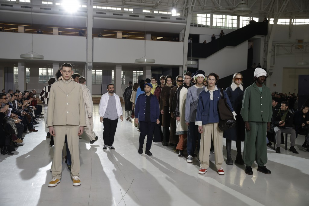 Designers Simone Rizzo, centre left, and Loris Messina, centre right, pose with models at the end of the Sunnei men's Fall-Winter 2019-20 collection,
