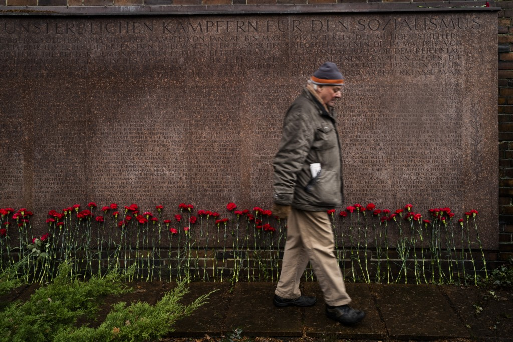 Carnations are placed in front of a memorial stone with names of socialists at a cemetery Berlin, Sunday, Jan. 13, 2019. Prominent figures from the co