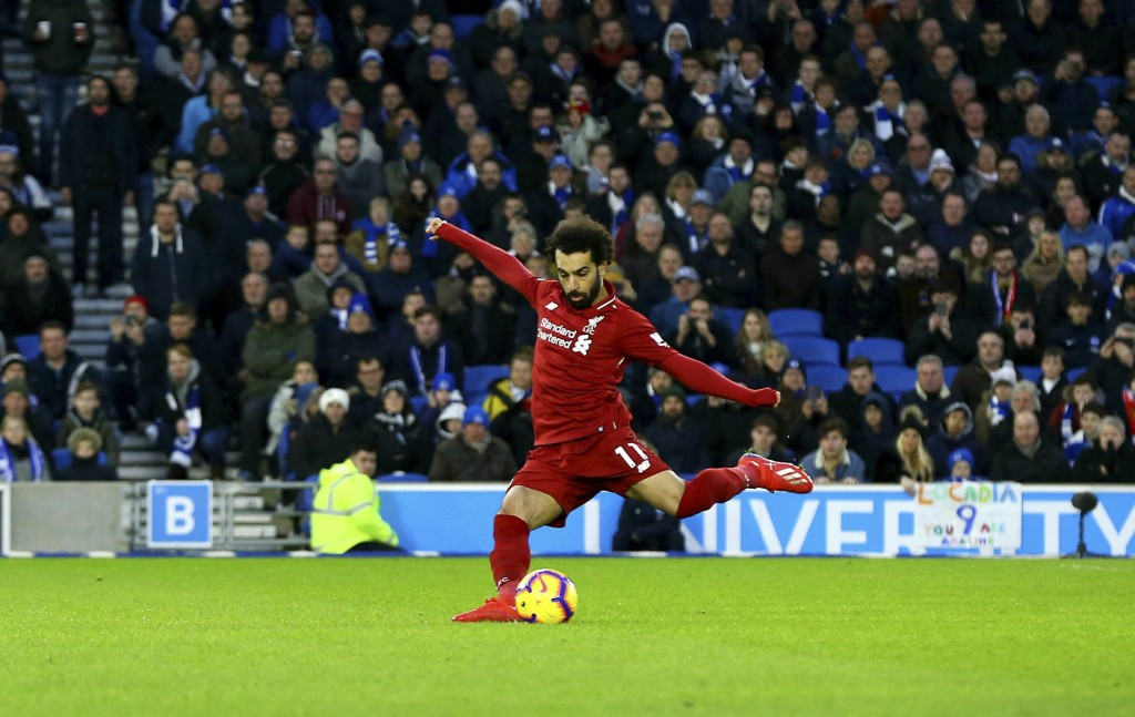 Liverpool's Mohamed Salah scores his side's first goal of the game from the penalty spot during the English Premier League soccer match between Bright