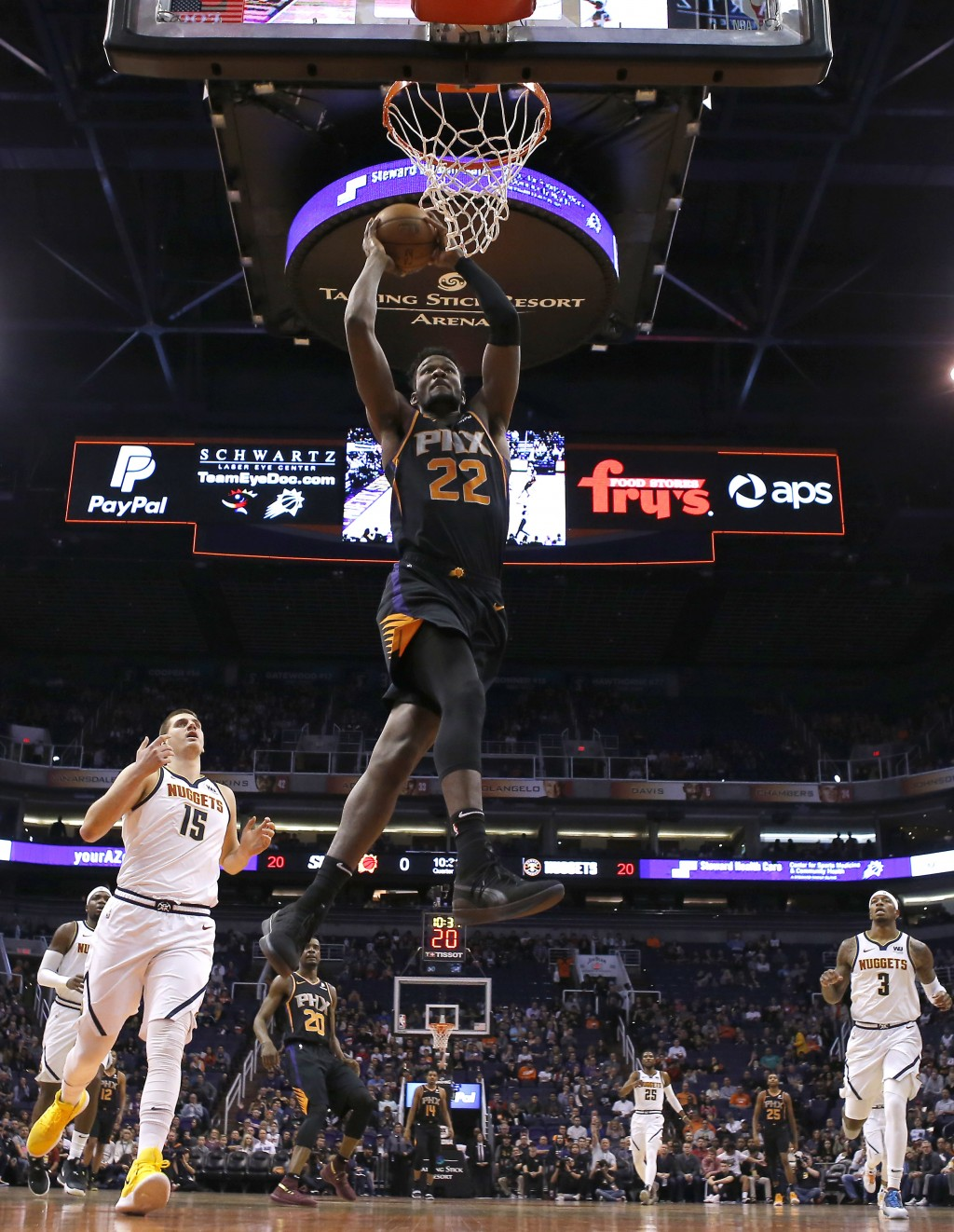 Phoenix Suns center Deandre Ayton (22) dunks against the Denver Nuggets in the second half during an NBA basketball game, Saturday, Jan. 12, 2019, in