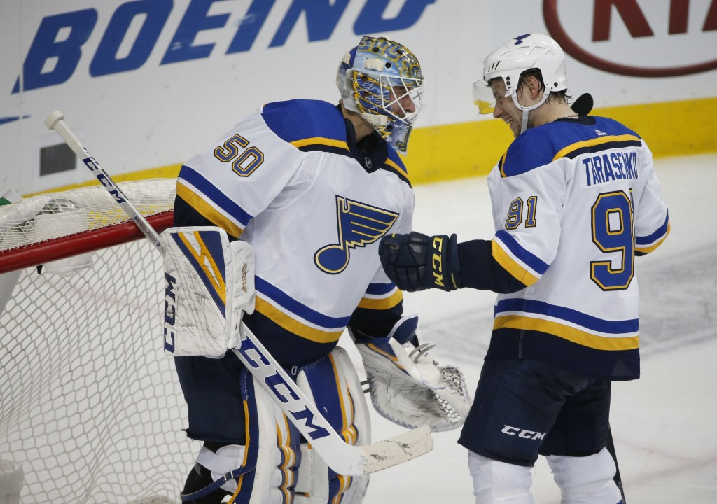 St. Louis Blues goaltender Jordan Binnington (50) and right wing Vladimir Tarasenko (91) congratulate each other after the Blues defeated the Dallas S