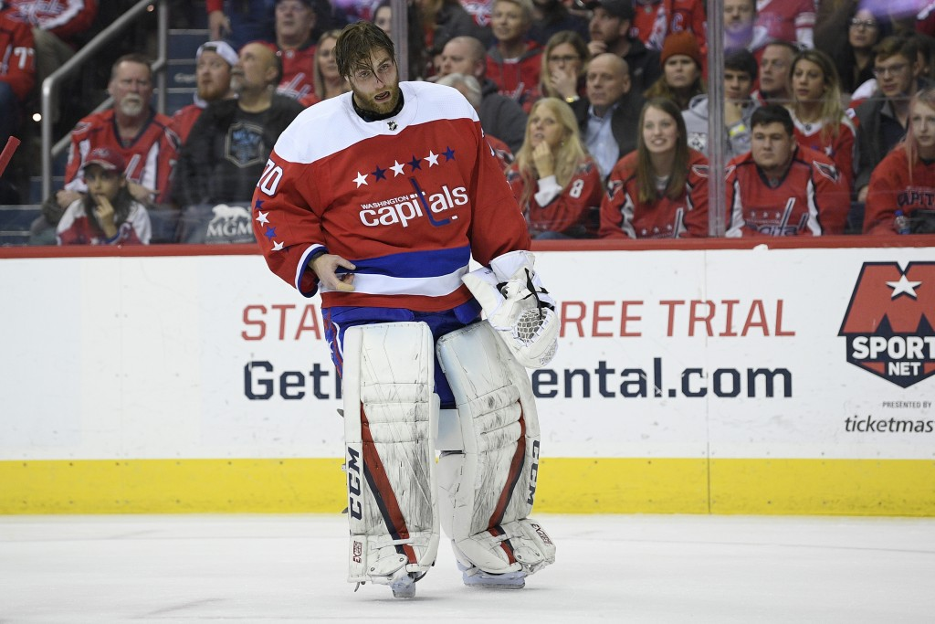Washington Capitals goaltender Braden Holtby (70) stands on the ice after he was injured during the second period of an NHL hockey game against the Co