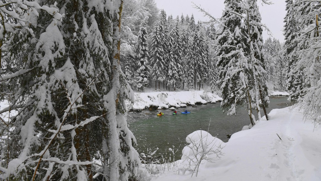 Kayaker make their way on the river Saalach on Saturday, Jan. 12, 2019 in Lofer, Austrian province of Salzburg.(AP Photo/Kerstin Joensson)